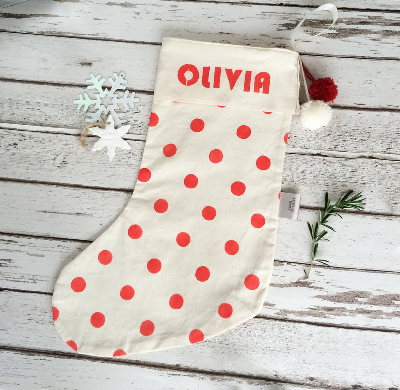 30 Modern Christmas Decor Ideas For Your Home // A simple cotton stocking personalized with polka dots and a name is a fun way to create a family mantle with no fear of confusion on Christmas morning.