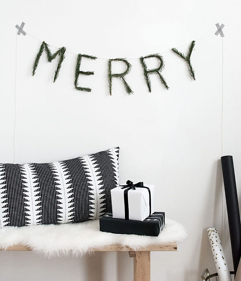 30 Modern Christmas Decor Ideas For Your Home // This DIY garland brings in a touch of nature and a cheerful Christmas message.