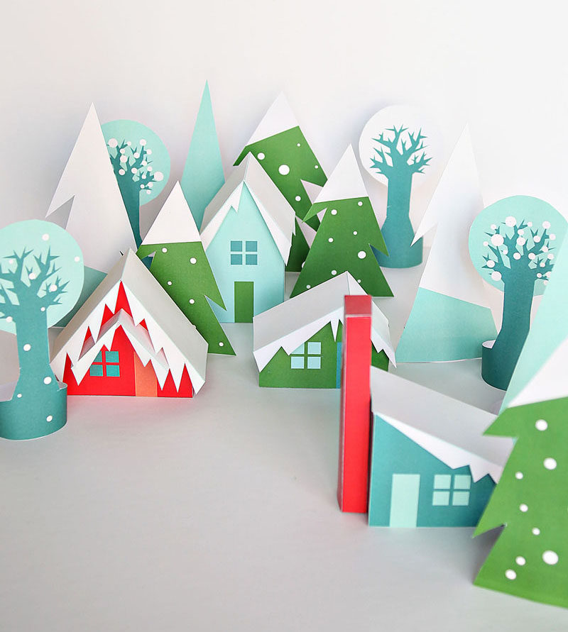 30 Modern Christmas Decor Ideas For Your Home // This printable paper village in fun colors with modern houses makes for a fun winter scene that be used over and over throughout the years.