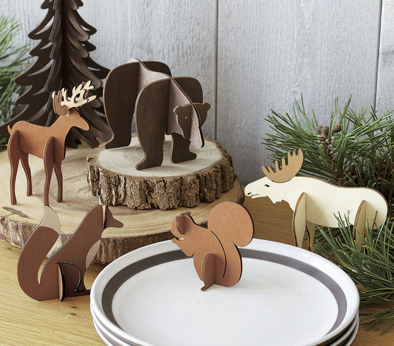 30 Modern Christmas Decor Ideas For Your Home // These laser cut wood animals are the perfect additions to your winter scenes.