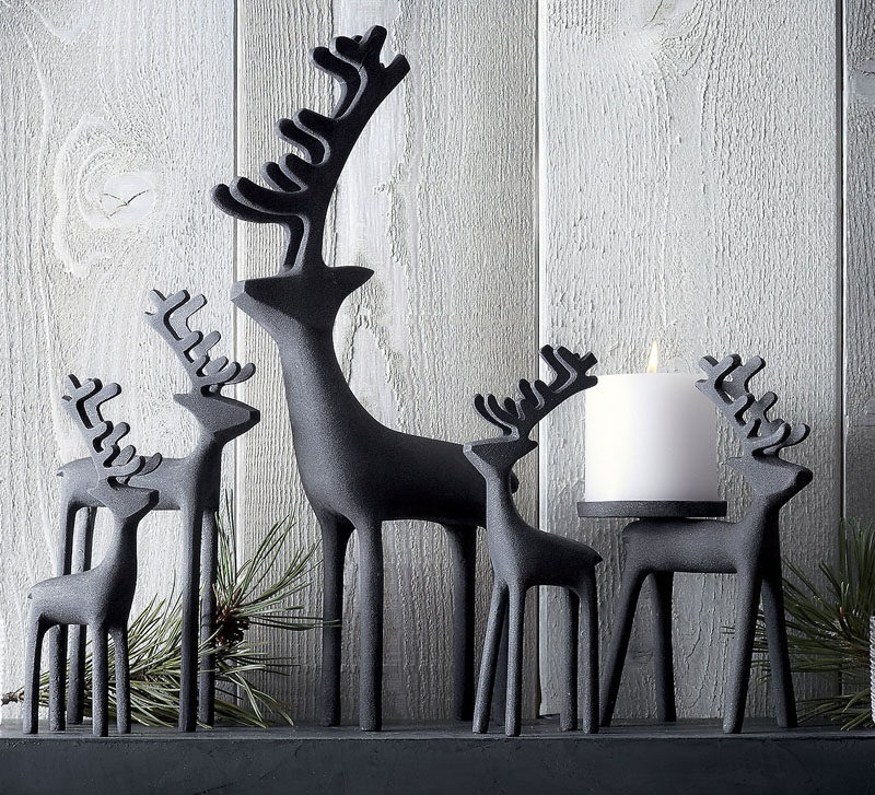 30 Modern Christmas Decor Ideas For Your Home // Zinc reindeer add a modern look to your mantle and a festive feel to your home.
