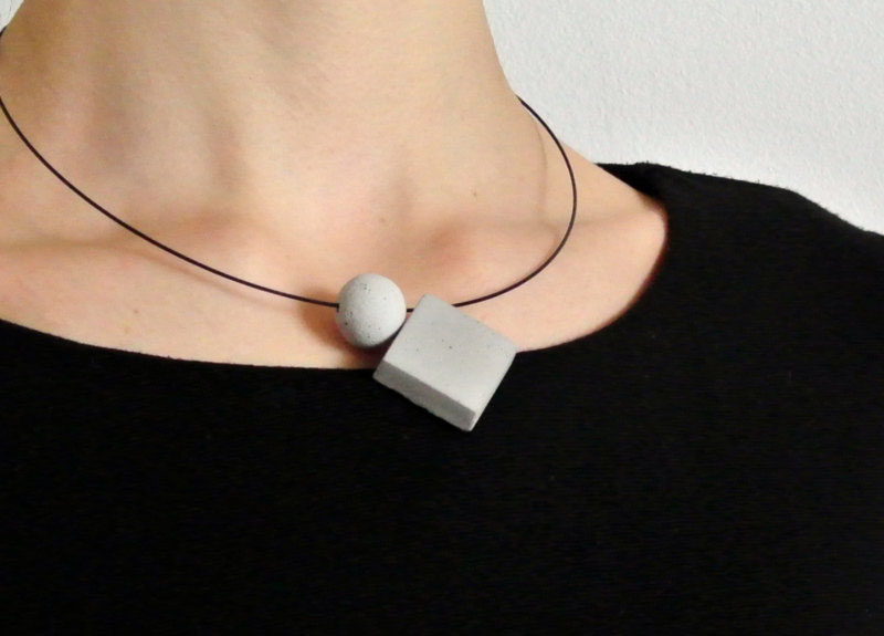 The Ultimate Gift Guide For The Modern Woman (40 Ideas!) // Concrete geometric pendants on a matte black necklace make a simple statement and can be dressed up and down. #ConcreteNecklace #GiftIdeas