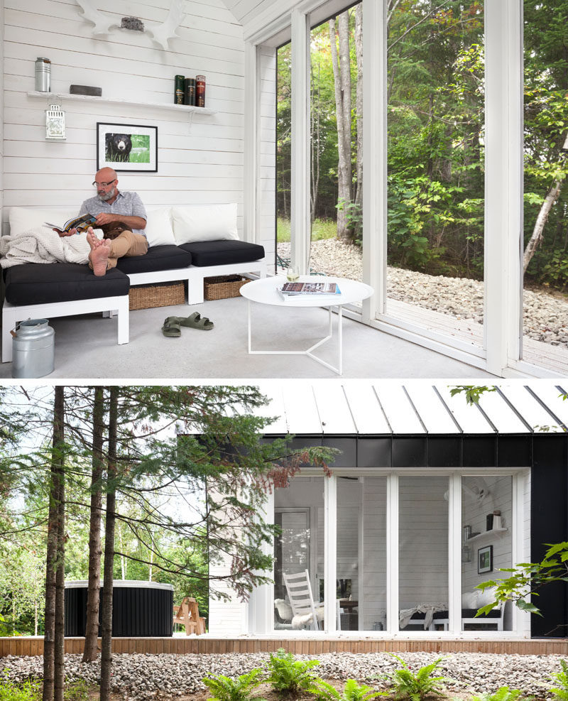 This cabin in the woods has a quiet reading room with views of the trees.