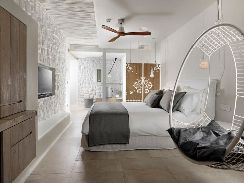 This Boutique Hotel Room In Mykonos Features Decorative Artistic Wooden Panels Hanging From The Ceiling