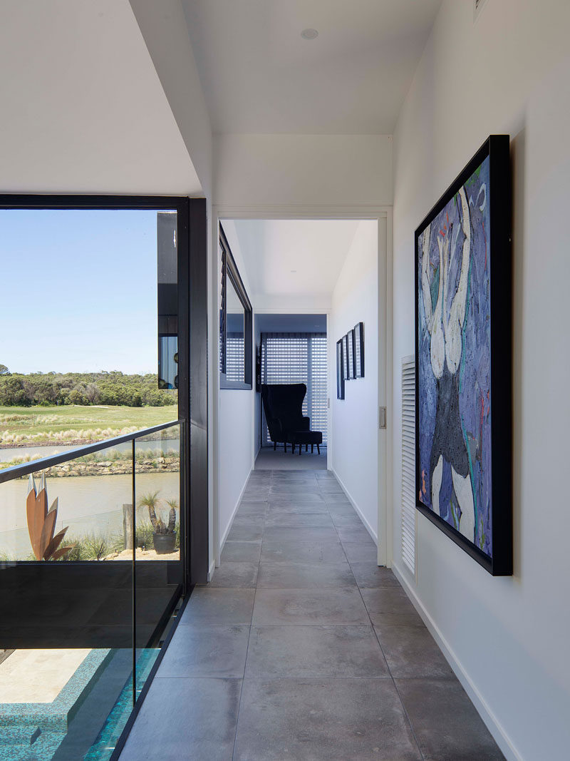 This tiled hallway overlooks the living area below.