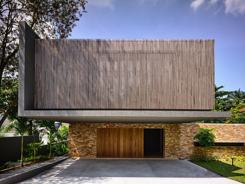This house combines wood, concrete and brick for a modern look.