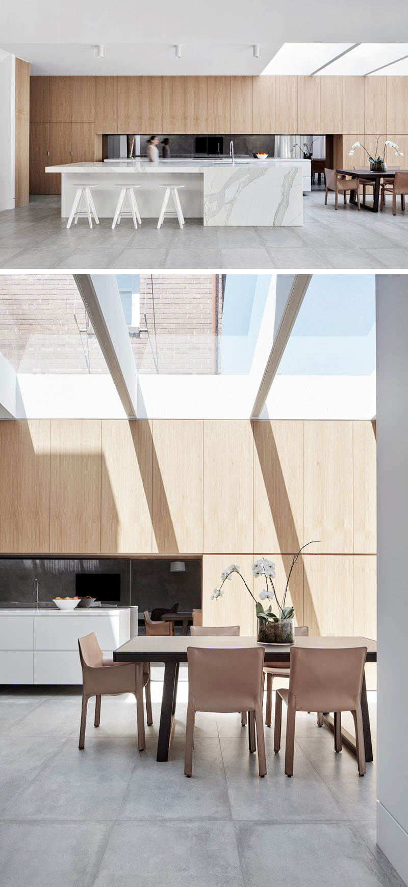 This modern kitchen has a nice light feel to it with the use of light wood and light marble. The dining room shares the space and has plenty of natural light from the large skylight above.