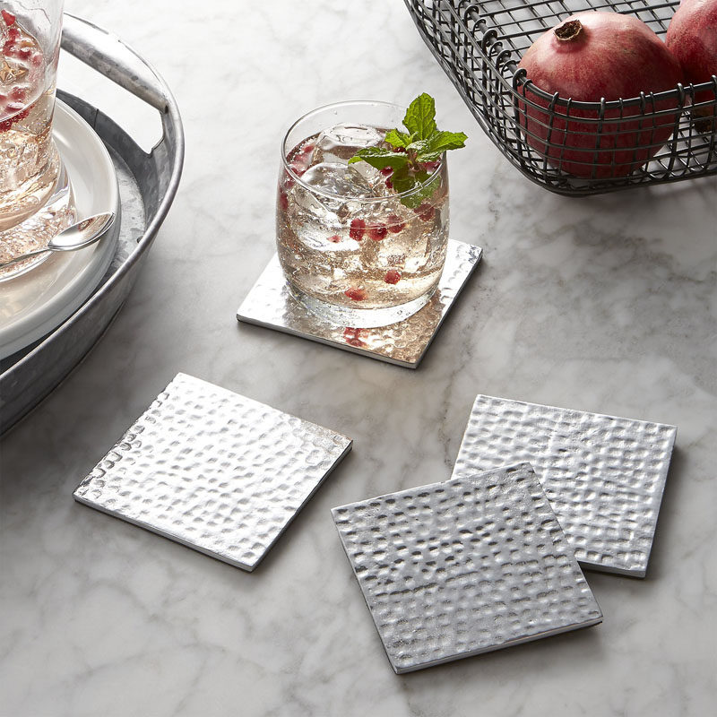 15 Host(ess) Gifts To Make You The Favorite Guest // Coasters are a practical gift that adds more functionality to the host's home. That fancy wood table can now be covered in stylish coasters and protected from the condensation dripping down champagne flutes and cocktail glasses.