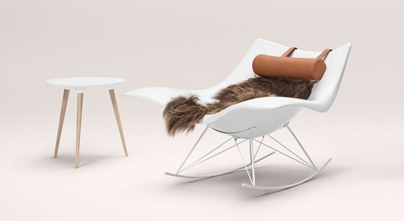 The polypropylene body of this rocking chair can warmed up by a soft lambskin and comfortable neck pillow. #ModernRockingChair #RockingChair #SeatingDesign #FurnitureDesign