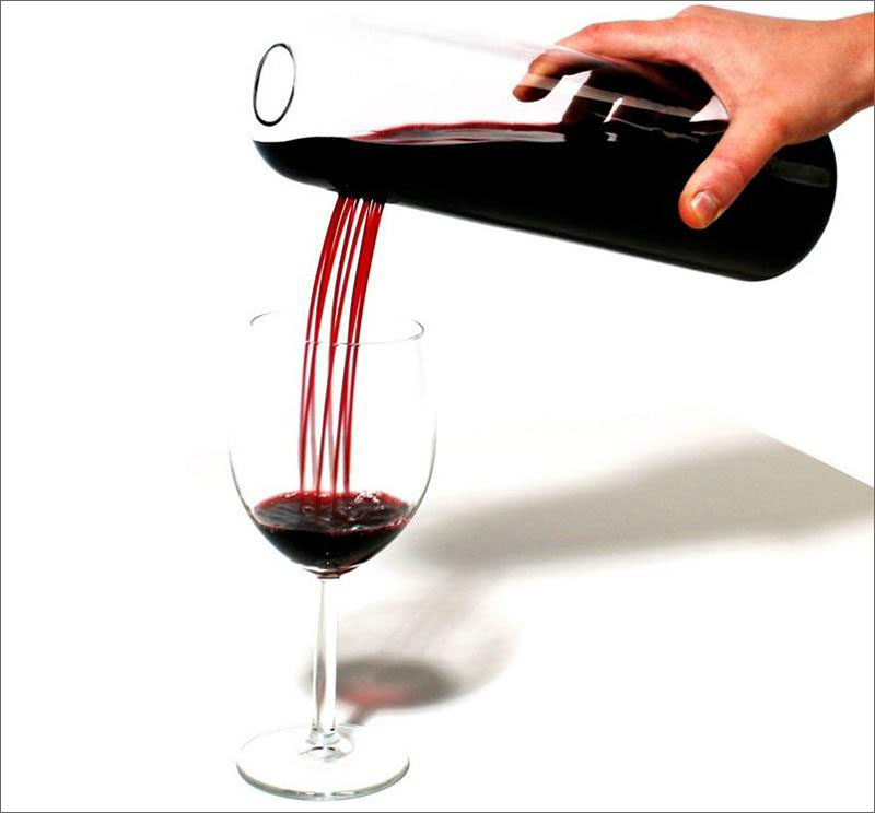 10 Unique Modern Wine Decanters // A number of small holes in the side of this decanter creates a unique pouring experience and helps to aerate the wine even more when it's being poured.