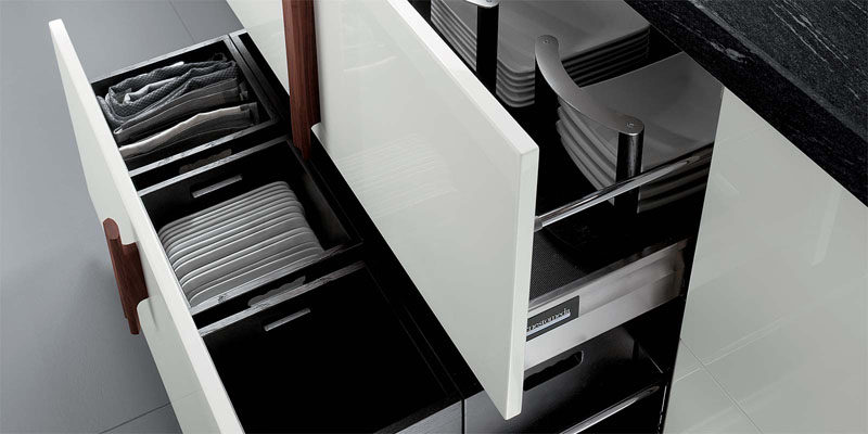 Kitchen Drawer Organization - Design Your Drawers So Everything Has A Place // Non-slip material lines the bottom of the drawers to make sure the plates don't slide around, and dividers ensure that the plates stay where they're supposed to.