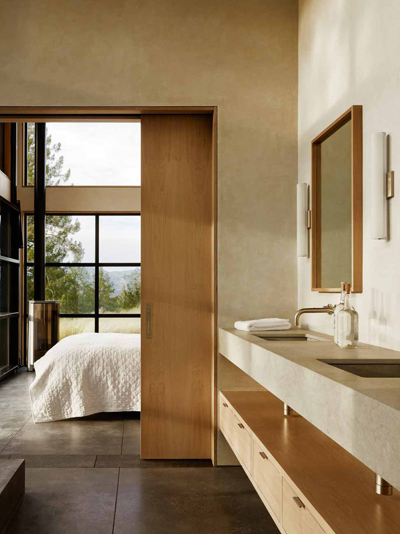 A wooden pocket door separates the bedroom from the bathroom and saves room.