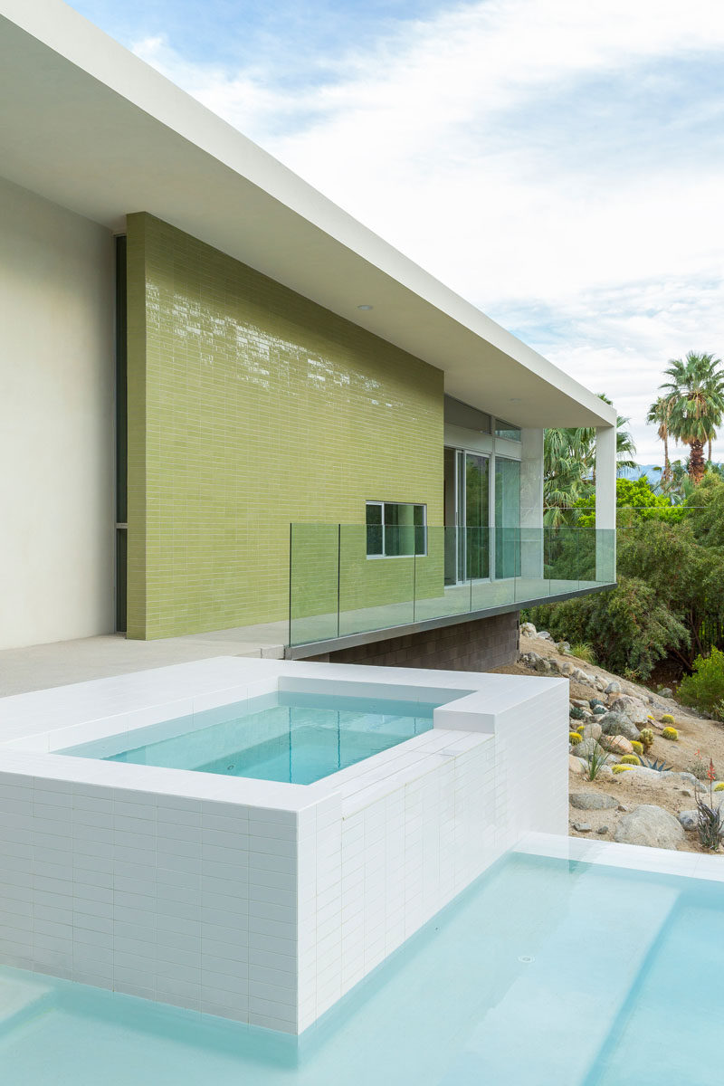 Green tile has been used on the exterior of the master wing in this house.