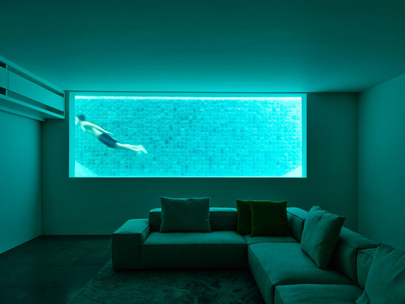 The basement of this home has a window that looks into the pool.