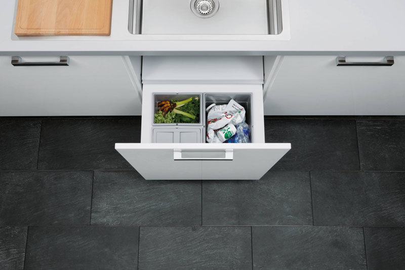 Kitchen Design Idea - Hide Pull Out Trash Bins In Your Cabinetry // Multiple bins in this built in drawer system make sorting and organizing food waste, garbage and recycling much easier.