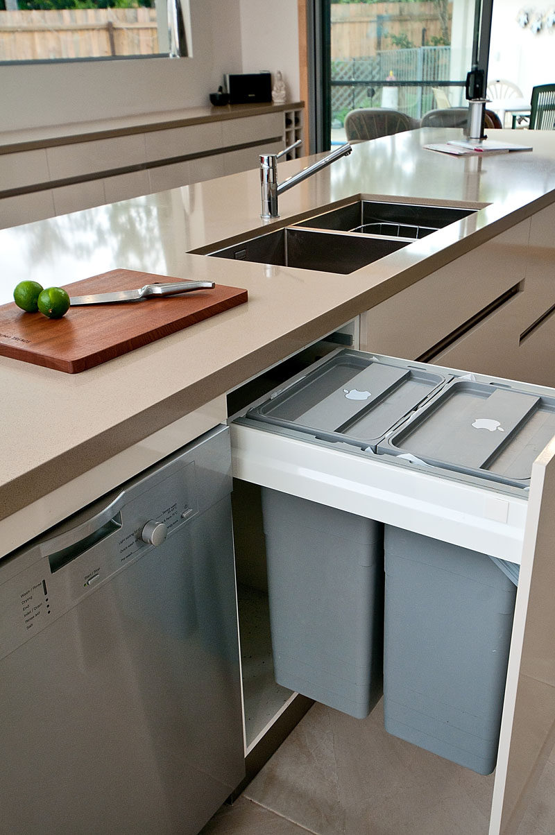 Kitchen Design Idea - Hide Pull Out Trash Bins In Your Cabinetry // Having the pull out trash bins right next to the sink and dishwasher makes it easy to scrape left over food into the garbage then load them into the dishwasher.
