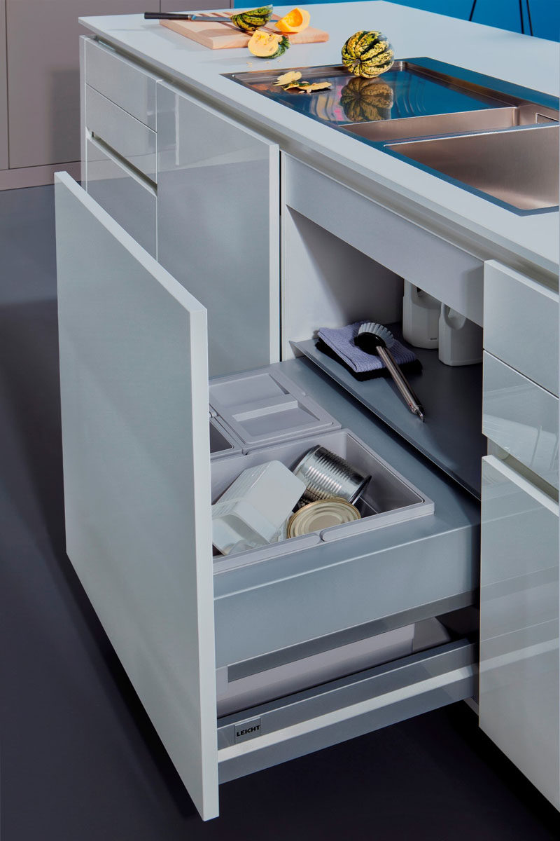 Kitchen Design Idea - Hide Pull Out Trash Bins In Your Cabinetry // The handles on the bins make it easy to pull them out when they're full and carry them out to the curb.
