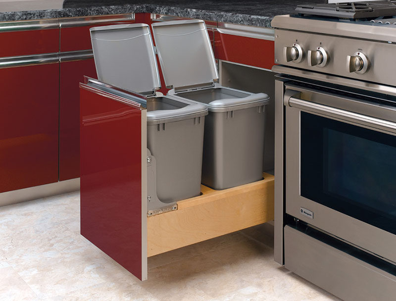 Kitchen Design Idea - Hide Pull Out Trash Bins In Your Cabinetry // The lids on these pull out help keep odors contained and can easily be removed when it's time to take out the bag or dump out the compost.