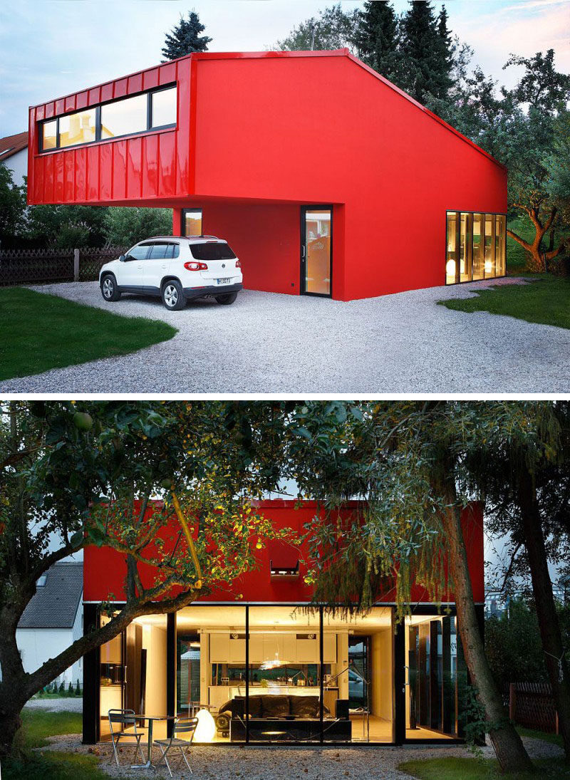 11 Red Houses And Buildings That Aren't Afraid To Make A Statement // A mix of matte and shiny red make up the exterior of this modern, angular home.
