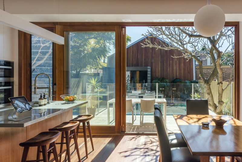 This combined kitchen and dining room open up to a balcony that overlooks the backyard.