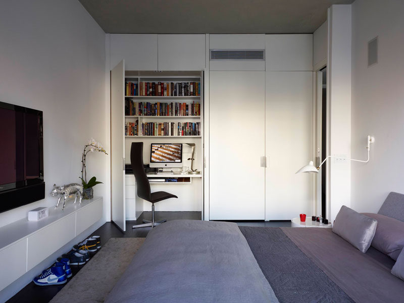 Small Apartment Design Ideas - Create A Home Office In A Closet // While one closet in this bedroom holds clothes the other contains a work space complete with a desk, book shelves, and storage drawers.