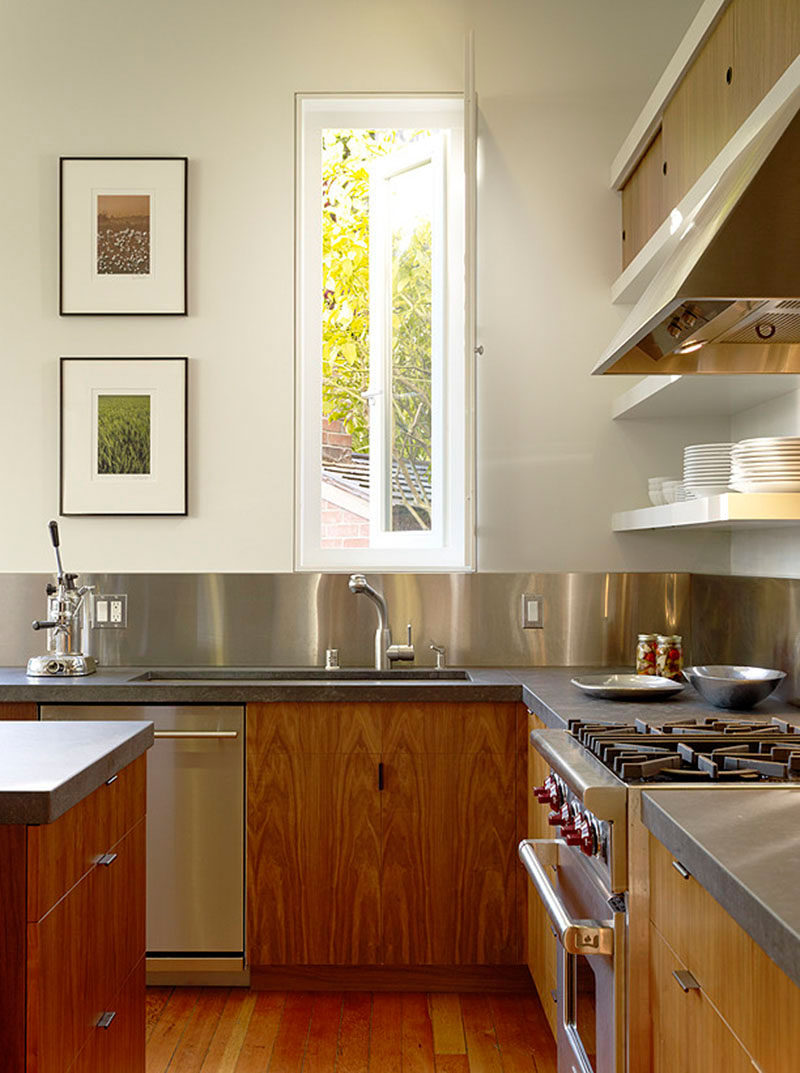 Kitchen Design Idea - Stainless Steel Backsplash // Stainless steel panels  wrap around the walls