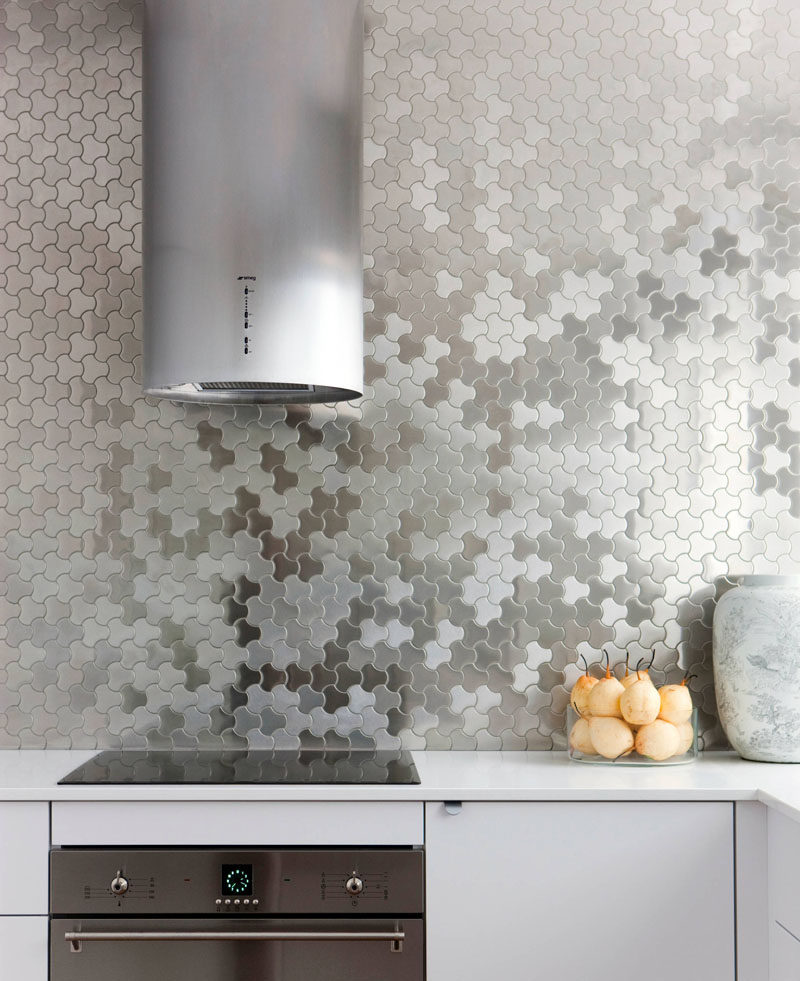 Kitchen Design Idea - Stainless Steel Backsplash // Stainless steel tiles cover the back wall of this modern kitchen to create a unique look that's easy to clean.