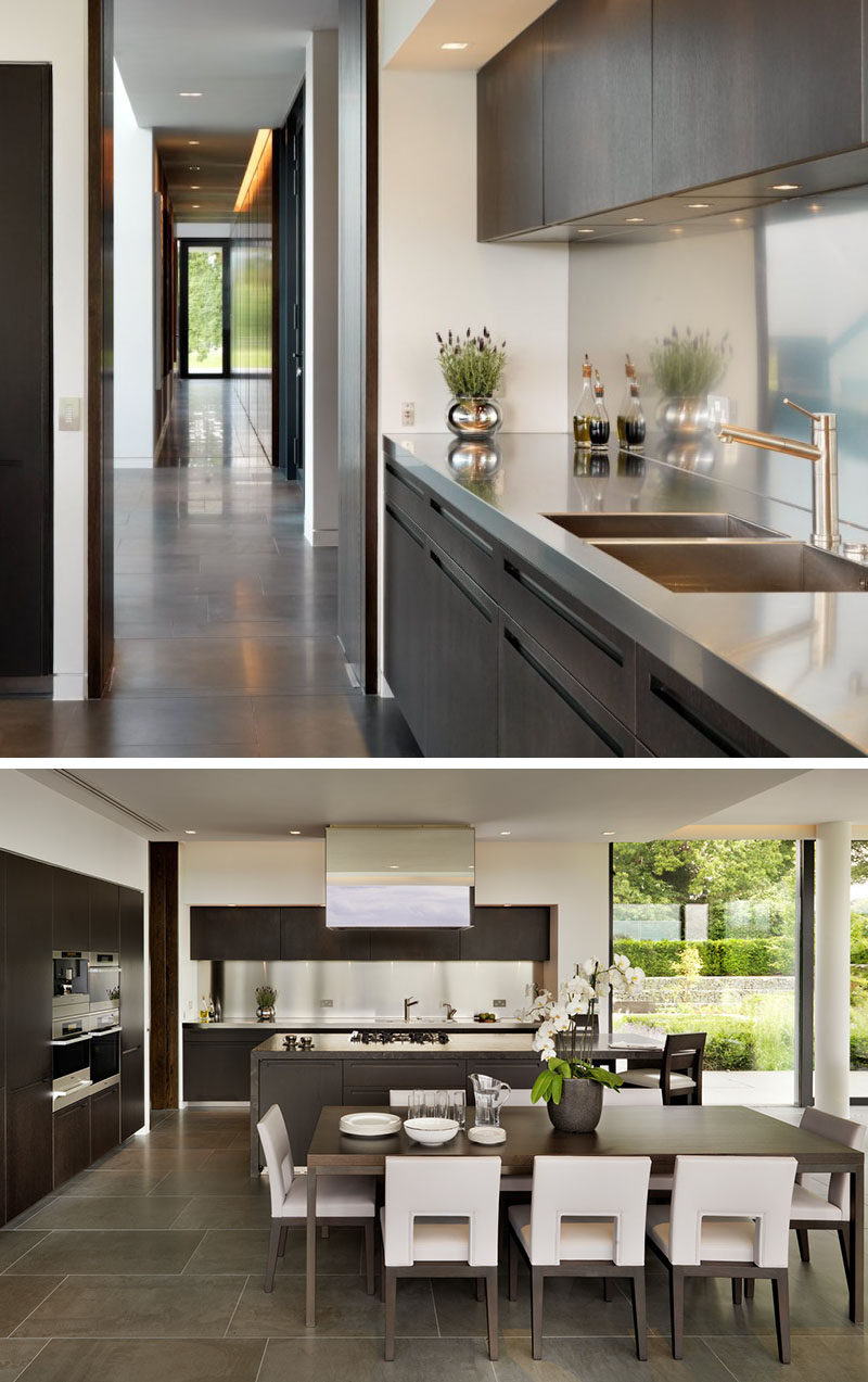 Kitchen Design Idea - Stainless Steel Backsplash // A single strip of shiny stainless steel lines the backsplash of this kitchen to match the countertops and kitchen appliances.