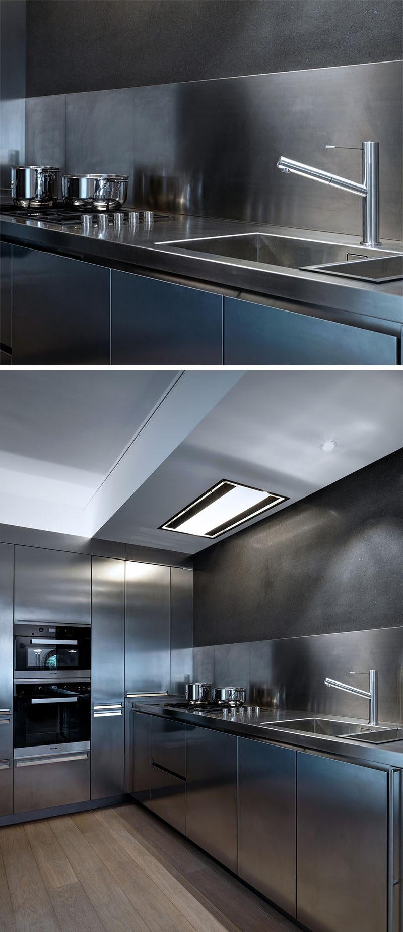 Kitchen Design Idea - Stainless Steel Backsplash // Everything in this kitchen is stainless steel, including the countertops and backsplash.
