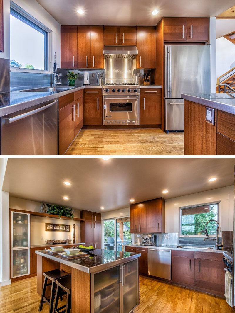 Kitchen Design Idea - Stainless Steel Backsplash // The stainless steel backsplash in this kitchen matches the appliances and the island and helps to brighten up the space.