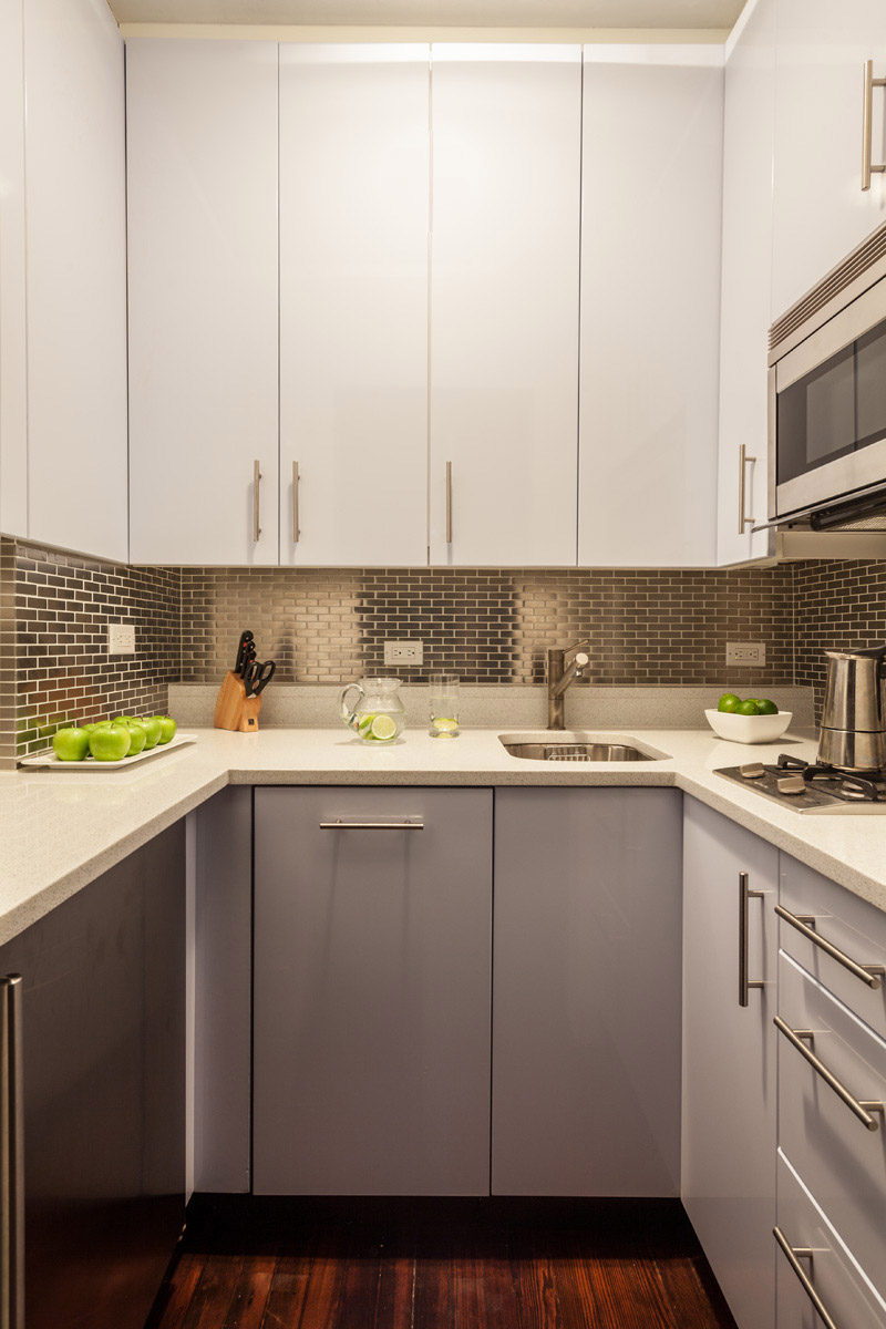 The Brick Like Arrangement Of These Stainless Steel Tiles Adds Texture And Brightness To This Tiny Kitchen