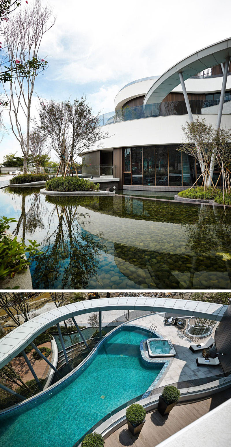 This clubhouse is surrounded by a landscaped pond, that can also be seen from the swimming pool, located on a different level of the building.