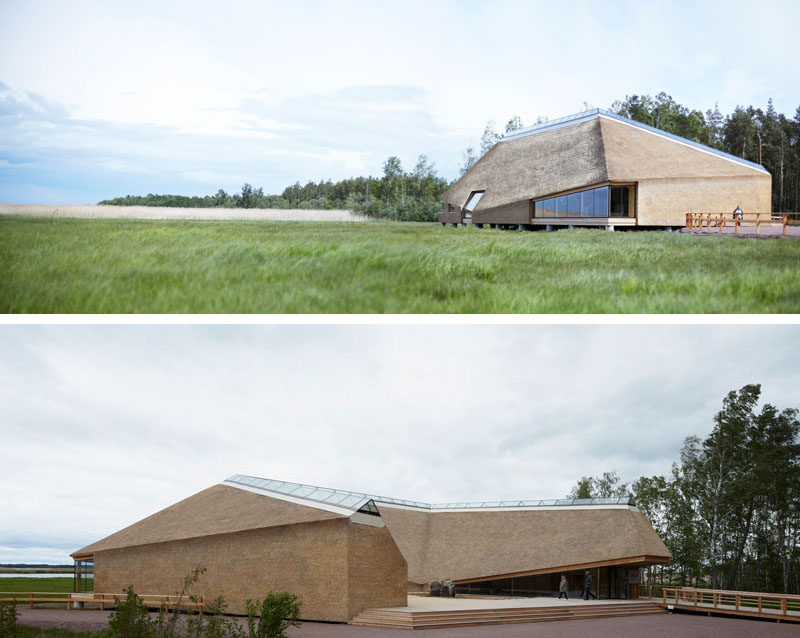 12 Examples Of Modern Houses And Buildings That Have A Thatched Roof // A skylight runs the length of the roof of this visitors centre, while the rest of the roof and the exterior walls are covered with thatch, in keeping with the natural surroundings.