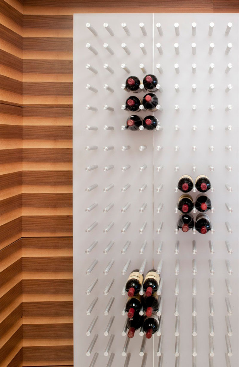 Wine rack ideas show off your bottles with a wall for Wall pegs and racks