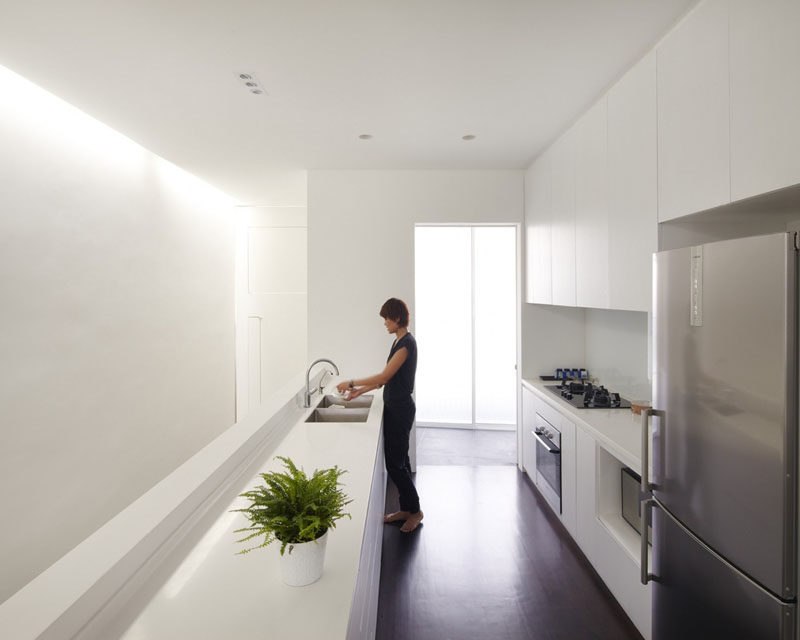 Kitchen Design Ideas - White, Modern and Minimalist Cabinets // This all white kitchen features white handle-less cabinetry to create a smooth streamlined look.