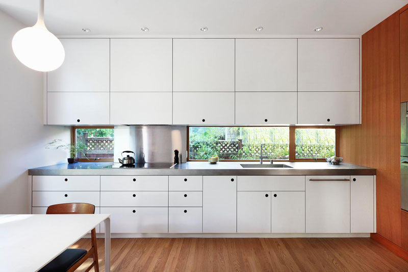 Kitchen Design Ideas - White, Modern and Minimalist Cabinets // Crisp white cabinetry in this kitchen brightens up the wood and creates a more modern look.