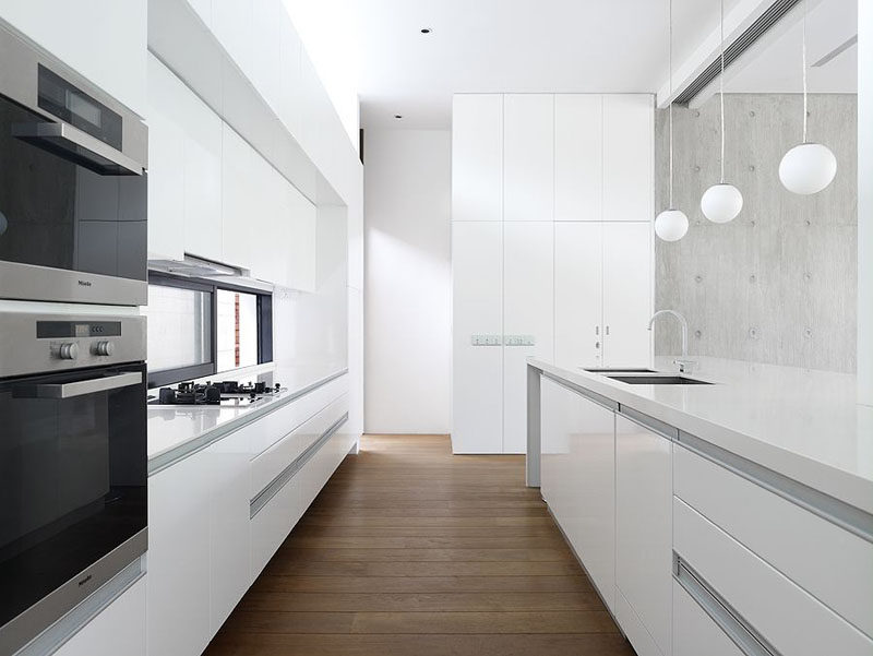 The Hardware Free White Cabinets Of This Kitchen Are Softened Up By Warm  Wood Flooring.