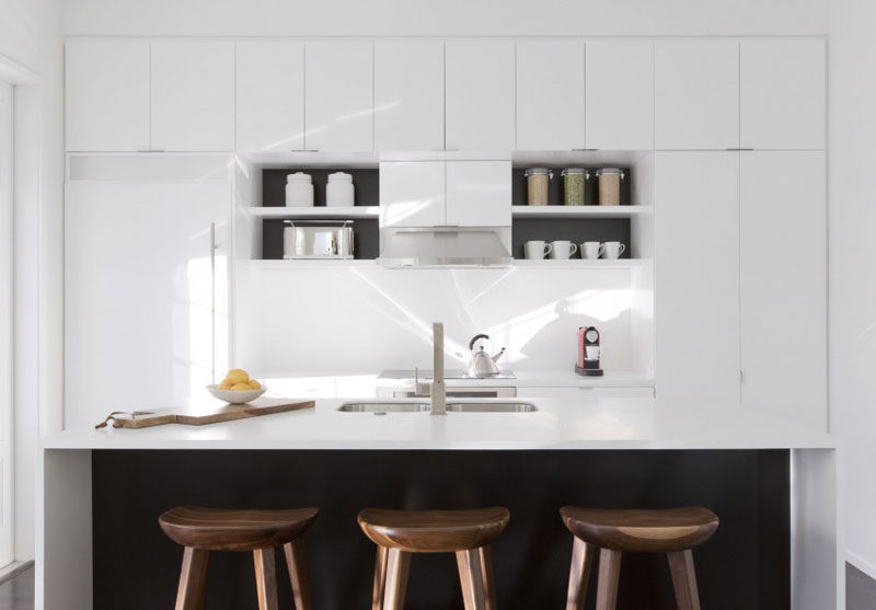 Kitchen Design Ideas - White, Modern and Minimalist Cabinets // There's just the right amount of black in this kitchen to contrasts the all white cabinetry.