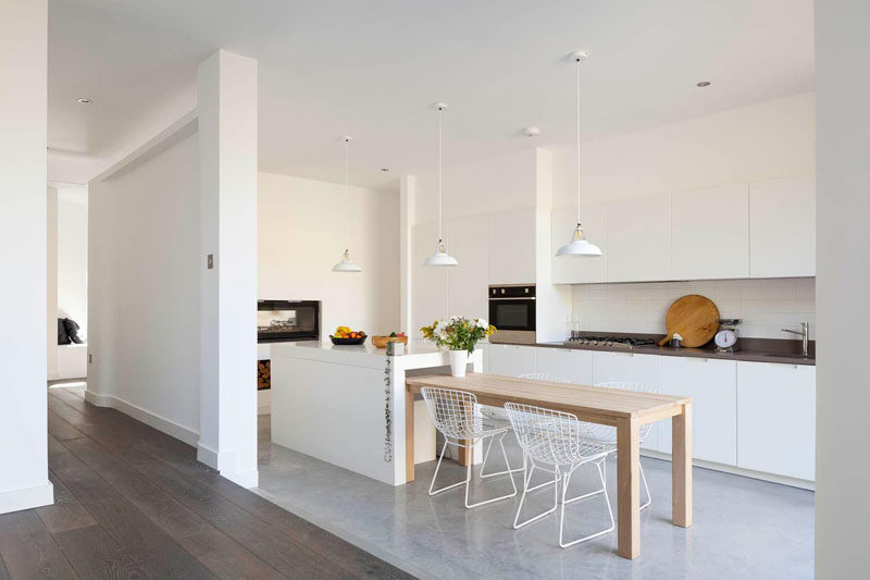 Kitchen Design Ideas - White, Modern and Minimalist Cabinets // The white cabinets in this kitchen appear to blend right into the white walls and create the illusion that they reach up to the ceiling.