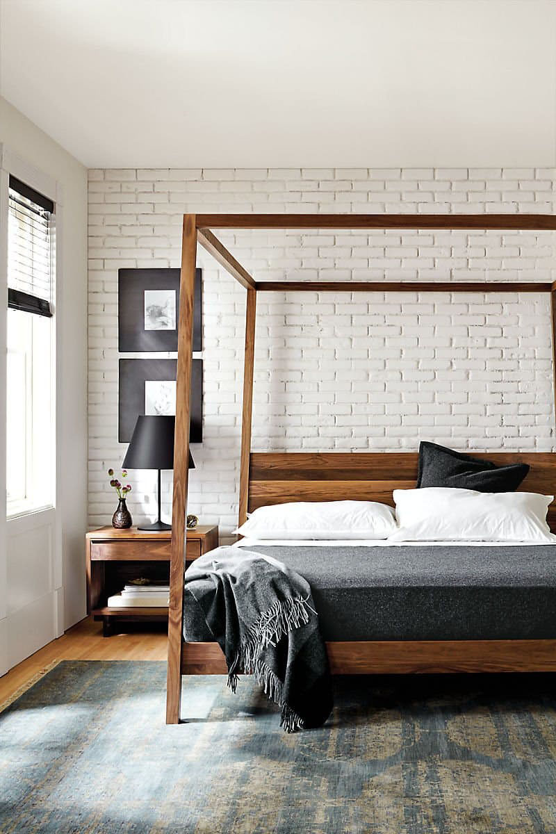 Bedroom Design Idea - 7 Ways To Create A Warm And Cozy Bedroom // Use a wooden bed frame to add warmth to a room.