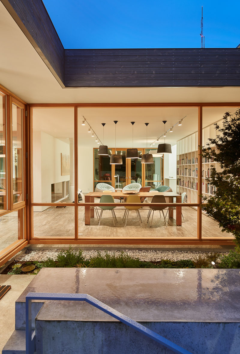 This contemporary home features custom designed wood framed windows.