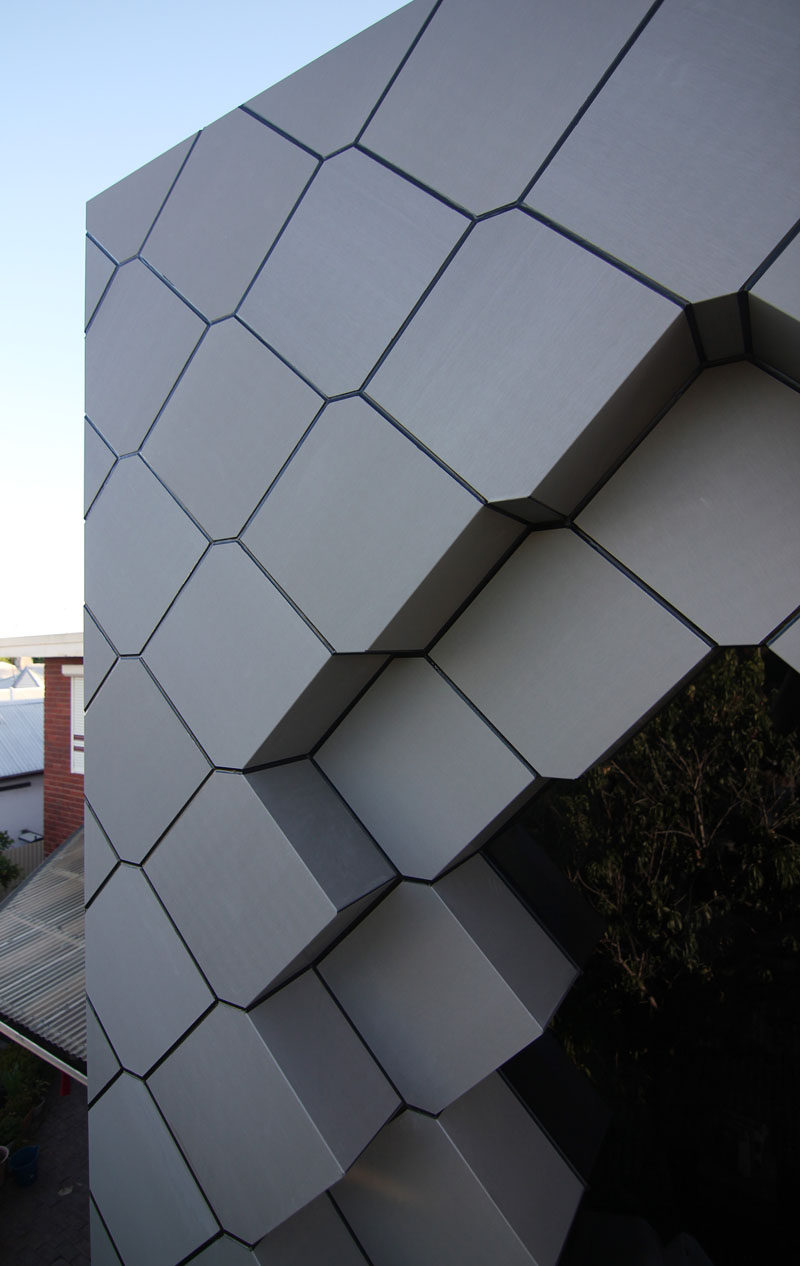 38 panels make up the unique facade of this home addition and it was constructed using zinc-faced composite panels.