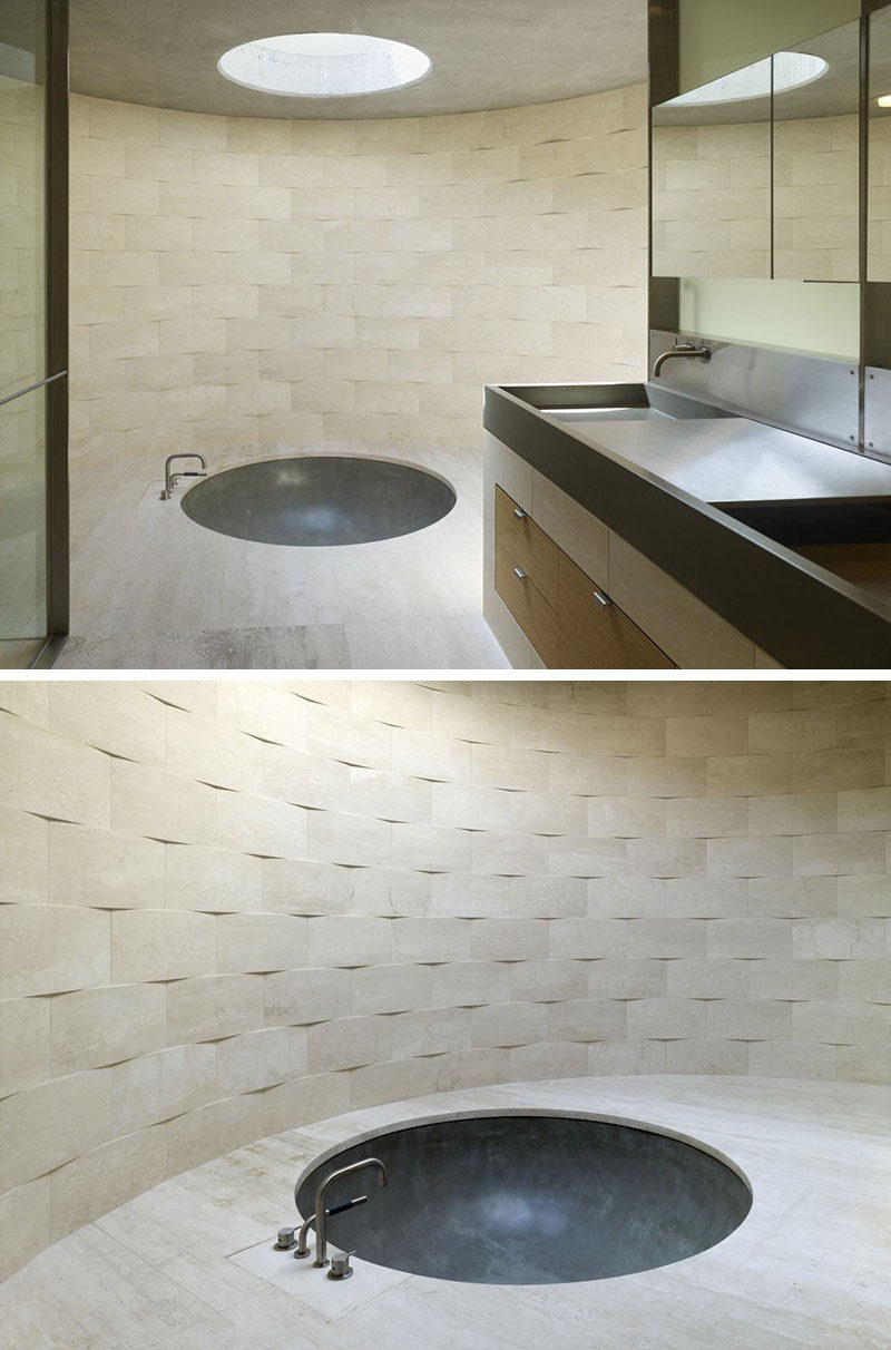 Bathroom Tile Ideas - Install 3D Tiles To Add Texture To Your Bathroom // The slightly curved tiles on the walls of this bathroom have been arranged so that you can clearly see their unique shape that gives the bathroom a textured look.