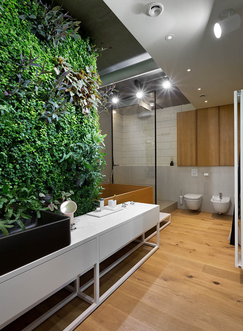 Bathroom Design Ideas - Black Shower Frames // The black frame around the shower adds a modern, industrial touch to the natural elements of wood and greenery throughout the bathroom.