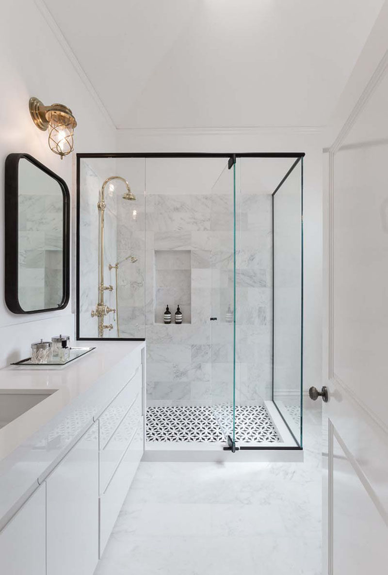 Bathroom Design Ideas - Black Shower Frames // The black frame around the perimeter of the glass on this shower carries around onto the counter to clearly define the shower area and contrast the traditional looking gold hardware.