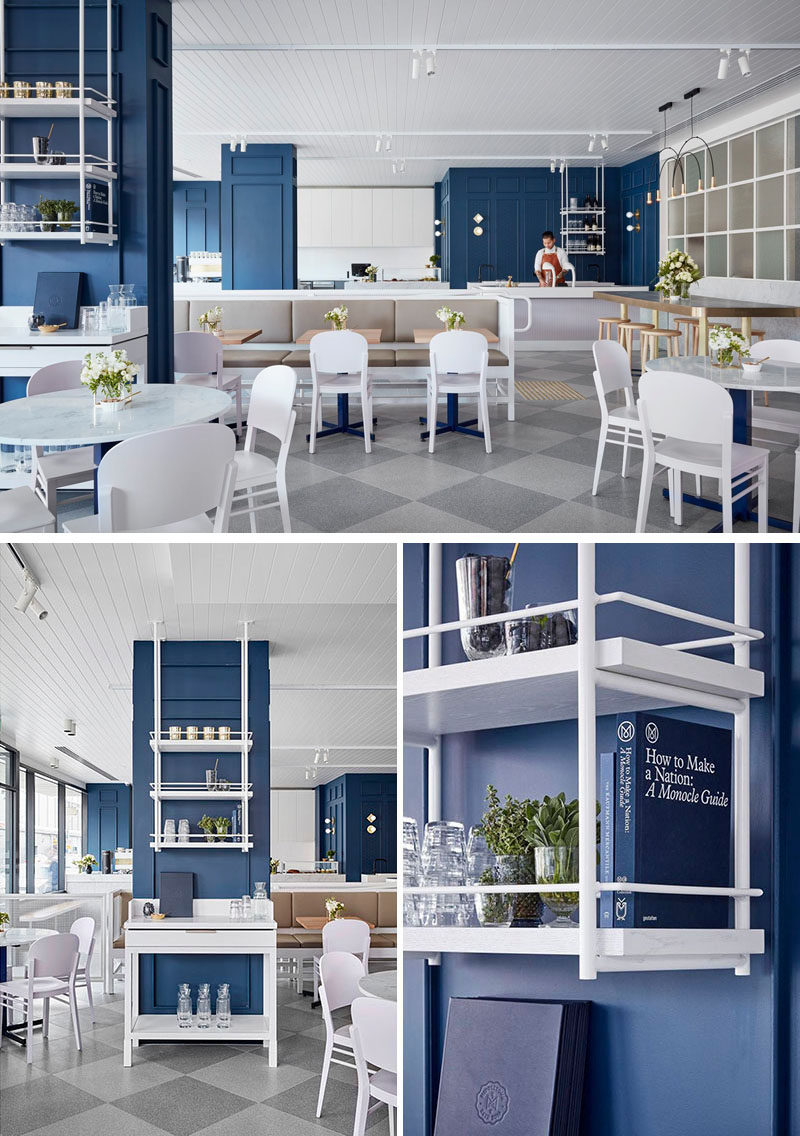 The design of this cafe has been softened with the use of feminine details such as accents of brass, pastel furnishings and pale timber.