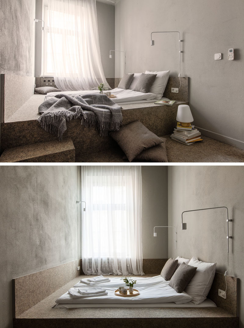 The beds in this apartment have been built-in to the design of the room and are raised up from the floor.
