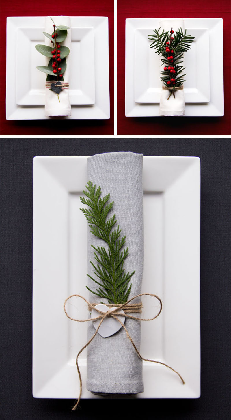 15 Inspirational Ideas For Creating A Modern Christmas Table Full Of Natural Elements // Natural greenery and berries on each napkin creates a more interesting table setting and is simple enough to make, even if you have lots of place settings to fill.