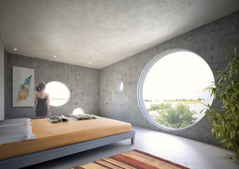 All of the rooms of this concept home have large circular windows with views of the surrounding area, which is perfect as the home has been designed to be a weekend retreat for city dwellers.
