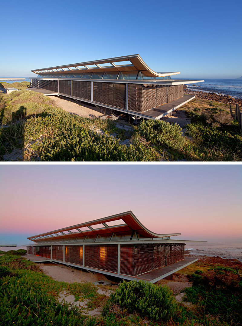 14 Examples Of Modern Beach Houses // This South African beach house is as close to the sea as it possibly can be and opens completely to make it feel like you're on the beach even while you're cooking dinner or lounging on the sofa.